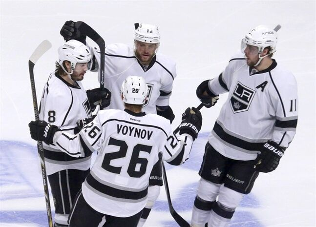 Los Angeles Kings defenseman Drew Doughty (8) celebrates his goal with teammates Marian Gaborik (12), Anze Kopitar (11), and Slava Voynov, during the third period of Game 2 of the Western Conference finals in the NHL hockey Stanley Cup playoffs against the Chicago Blackhawks Wednesday, May 21, 2014, in Chicago. (AP Photo/Charles Rex Arbogast)