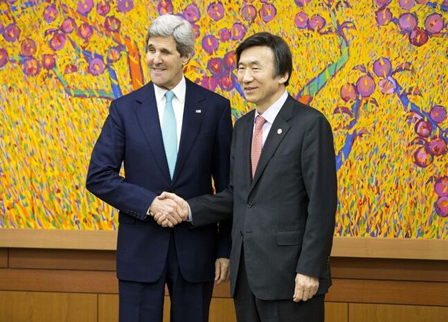 U.S. Secretary of State John Kerry, left, and South Korean Foreign Minister Yun Byung-se, right, shank hands during their meeting Thursday, Feb. 13, 2014, in Seoul, South Korea. Kerry is visiting South Korea, China, Indonesia, and the United Arab Emirates on a seven-day trip. (AP Photo/ Evan Vucci, Pool)