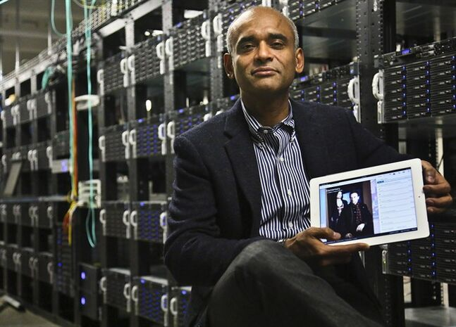 FILE - In this Thursday, Dec. 20, 2012 file photo, Chet Kanojia, founder and CEO of Aereo, Inc., poses with a tablet displaying his company's technology, in New York. The Supreme Court on Wednesday, June 25, 2014 ruled that Aereo has to pay broadcasters when it takes television programs from the airwaves and allows subscribers to watch them on smartphones and other portable devices. (AP Photo/Bebeto Matthews, File)