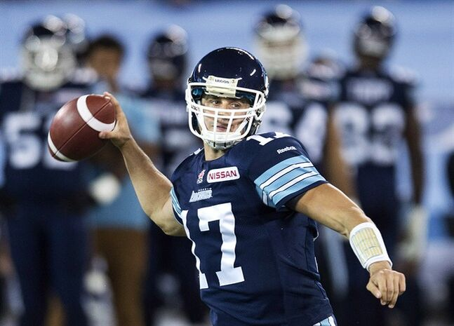 Toronto Argonauts quarterback Zach Collaros looks for a pass against the Montreal Alouettes during first half CFL football action in Toronto, on Friday, Nov. 1, 2013. He's still got roughly three weeks to get a deal done but Toronto Argonauts GM Jim Barker wouldn't be surprised to see sophomore quarterback Collaros test the CFL's free-agent waters. THE CANADIAN PRESS/Nathan Denette