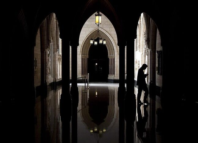 A person walks through the halls of the centre block on Parliament Hill in Ottawa in a 2010 photo. THE CANADIAN PRESS/Sean Kilpatrick