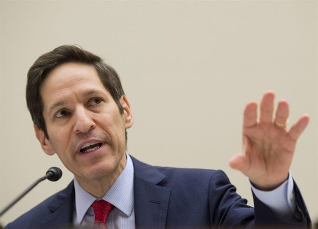 FILE - In this Aug. 7, 2014 file photo, Centers for Disease Control and Prevention (CDC) Director Dr. Tom Frieden testifies on Capitol Hill in Washington before the House subcommittee on Africa, Global Health, Global Human Rights, and International Organizations hearing on
