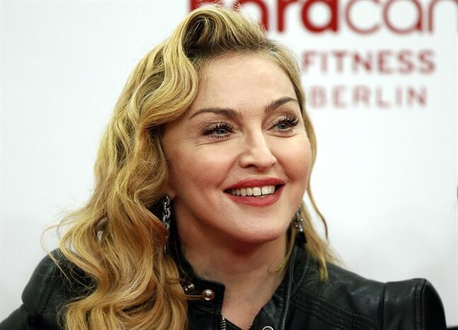 FILE - In this Oct. 17, 2013, file photo, U.S. pop star Madonna smiles during her visit at the