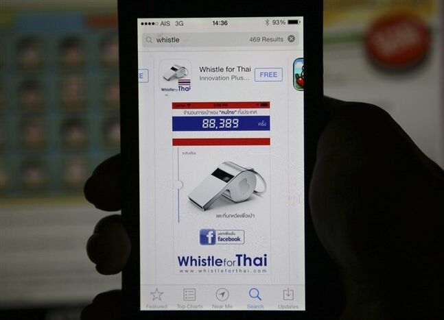Nok Weed, or Whistle app, is shown after being downloaded on a smartphone Friday, Dec. 13, 2013 in Bangkok, Thailand. More than 70,000 people have downloaded one application that mimics the shrieking sound of a whistle - the symbol of the