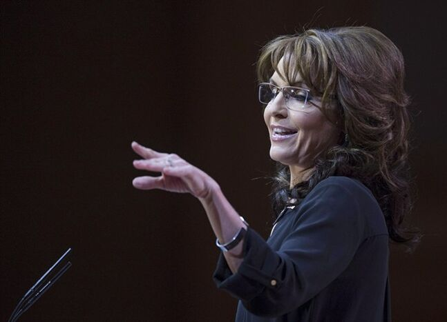 Former Alaska governor Sarah Palin gestures while she addresses the Conservative Political Action Committee annual conference in National Harbor, Md. on March 8, 2014. The movement to impeach U.S. President Barack Obama has had no realistic chance of success, no discernible groundswell of public support, but it now has a celebrity champion. THE CANADIAN PRESS/AP, Cliff Owen