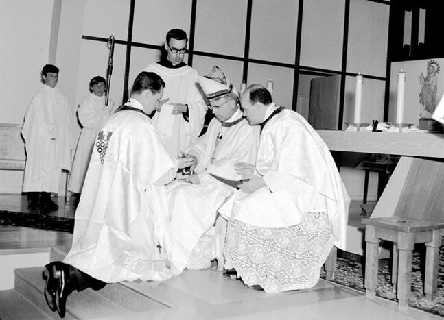 Marc Ouellet kneels before Mgr Gaston Hains during his ordination to priesthood in Saint-Luc Church in La Motte, Que. on May 25, 1968. THE CANADIAN PRESS/HO, Soci�t� d'Histoire d'Amos
