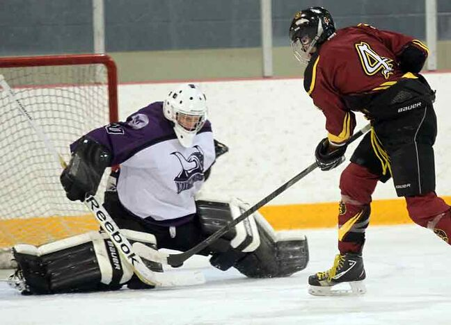 Crocus Plainsmen forward Layton Dornn goes five-hole to score his team's first goal on Vincent Massey Vikings netminder Blaine Cooper in Westman High School Hockey League action on Tuesday night at the Optimist Arena.