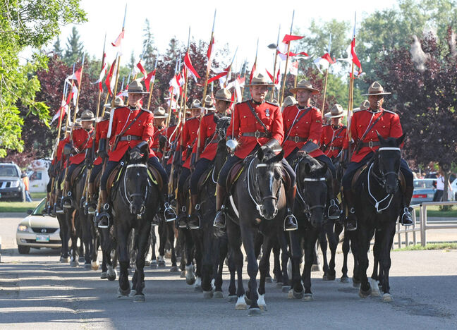 Members of the famed RCMP Musical Ride lead their mounts through the parking lot of the Keystone Centre following their performance at the 2008 Manitoba Heritage Tattoo.