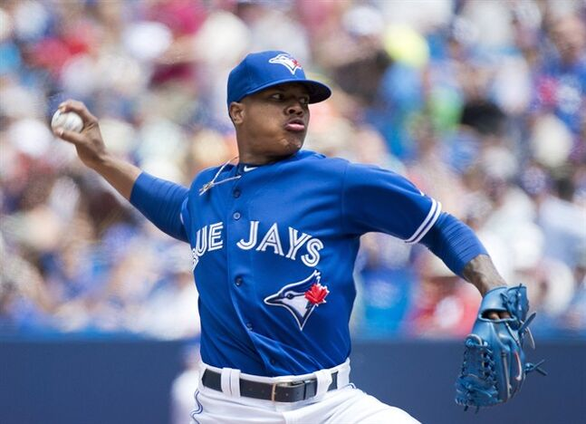 Toronto Blue Jays starting pitcher Marcus Stroman works against the Boston Red Sox during first inning AL baseball action in Toronto on Thursday, July 24, 2014. THE CANADIAN PRESS/Nathan Denette