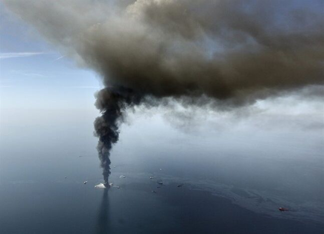 FILE - This aerial April 21,2010 file photo, taken in the Gulf of Mexico, more than 50 miles southeast of Venice on Louisiana's tip, shows an oil slick is seen as the Deepwater Horizon oil rig burns. The last-ditch safety device that didn't stop the 2010 BP oil spill had multiple failures, wasn't tested properly, and still poses a risk for many rigs drilling today, another federal investigation board concludes. The report issued Thursday by the U.S. Chemical Safety Board zeroes in on what went wrong with the blowout preventer and blames bad management and operations. They found two different sets of wrong wiring, a dead battery and a bent pipe in the hulking failsafe device. And that they said led to the dumping of 172 million gallons of oil into the Gulf of Mexico. (AP Photo/Gerald Herbert, File)