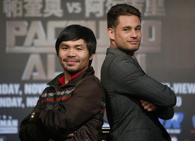 WBO Welterweight champion Manny Pacquiao, left, of the Philippines, and WBO junior welterweight champion Chris Algieri of United States, right, pose for photographers during a news conference in Macau, Monday, Aug. 25, 2014. The boxers are scheduled to battle in WBO welterweight title match at The Venetian Macao on Nov. 23 in Macau. (AP Photo/Vincent Yu)