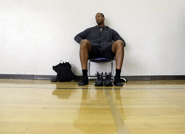 Brooklyn Nets center Jason Collins prepares for an off-day practice on the campus of UCLA in Los Angeles Tuesday, Feb. 25, 2014. Collins became the first openly gay athlete in North America's four major professional sports Sunday, Feb. 23, signing a 10-day contract with the Brooklyn Nets. (AP Photo/Reed Saxon)