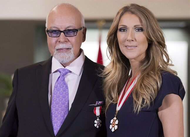 Canadian music star Celine Dion and husband Rene Angelil pose for photos after being decorated with the Order of Canada in Quebec City on Friday July 26, 2013. For the first time in her lengthy music career, Dion will have a manager other than Angelil.THE CANADIAN PRESS/Jacques Boissinot
