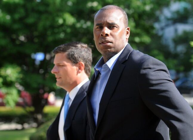 Former Long Island Ducks player Jose Offerman arrives at the federal courthouse in Bridgeport, Conn. on Thursday, July 17, 2014. Offerman is being sued by former Bluefish catcher Jonathan Nathans for injuries sustained in a charging the mound incident in a 2007 game between the two teams. Offerman played for the Boston Red Sox, Los Angeles Dodgers and other teams during a 15-year major league career that ended in 2005. (AP Photo/Connecticut Post, Autumn Driscoll) MANDATORY CREDIT