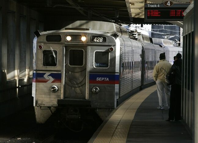 FILE - A SEPTA regional train, the R7, rolls into 30th Street station in Philadelphia in this Nov. 16, 2004 file photo. Four hundred workers at a Philadelphia-area regional rail system went on strike Saturday morning June 14, 2014, shutting down 13 train lines that carry commuters to the suburbs and Philadelphia International Airport. Subways, trolleys and buses operated by SEPTA will continue to run. (AP Photo/Jacqueline Larma, File)