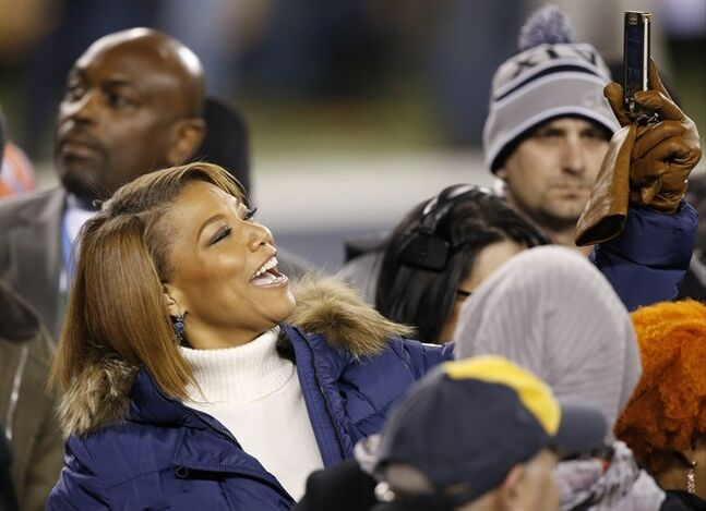 Queen Latifah arrives on the field before the NFL Super Bowl XLVIII football game Sunday, Feb. 2, 2014, in East Rutherford, N.J. (AP Photo/Kathy Willens)