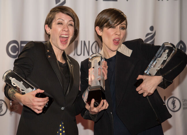 Identical-twin-sister act Tegan and Sara share a laugh after winning three Juno Awards — for single, pop album and group of the year — at the MTS Centre on Sunday.
