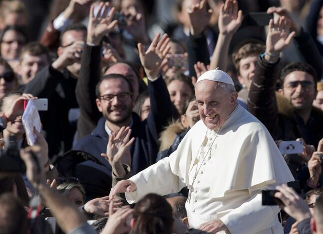 Pope Francis greets faithful as he leaves St. Peter's Square at the Vatican, Friday, Feb. 14, 2014. Pope Francis met a group of engaged couples on Valentine's Day. (AP Photo/Alessandra Tarantino)