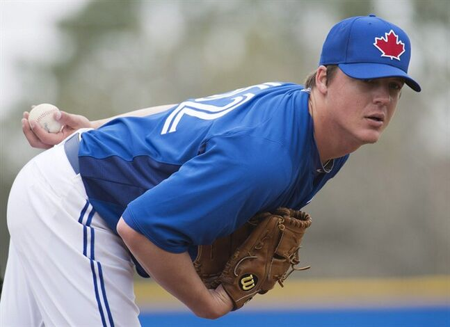 Toronto Blue Jays pitcher Aaron Loup pitches during baseball spring training in Dunedin, Fla., on Wednesday, Feb. 20, 2013. THE CANADIAN PRESS/Nathan Denette