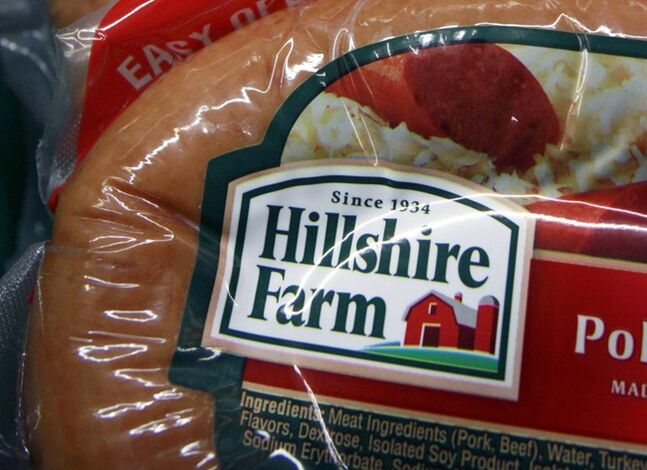 FILE - This Monday, Feb. 7, 2011, file photo shows Hillshire Farm products at Quality Market in Barre, Vt. Pilgrim's Pride on Tuesday, May 27, 2014 said it is offering to acquire meat producer Hillshire Brands in a deal worth about $5.58 billion. (AP Photo/Toby Talbot, File)