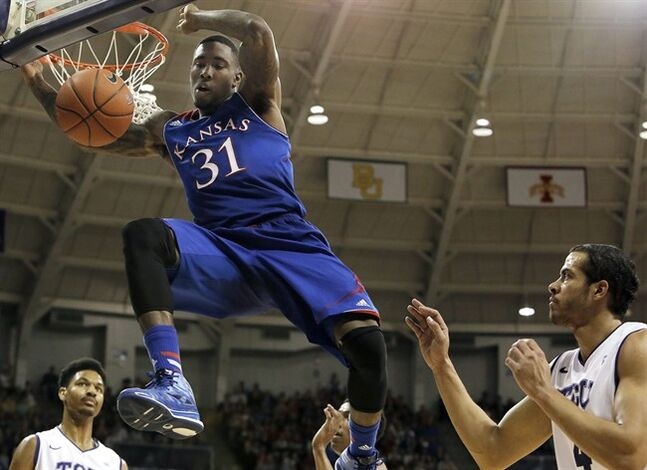 Kansas forward Jamari Traylor (31) dunks as TCU's Amric Fields, right, looks on in the first half of an NCAA college basketball game, Saturday, Jan. 25, 2014, in Fort Worth, Texas. (AP Photo/Brandon Wade)