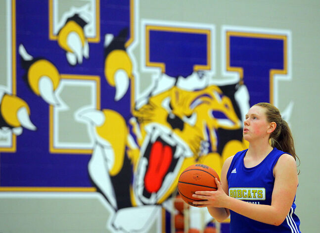 Aimee Johnston works on her shot in BU Bobcats practice on Wednesday.