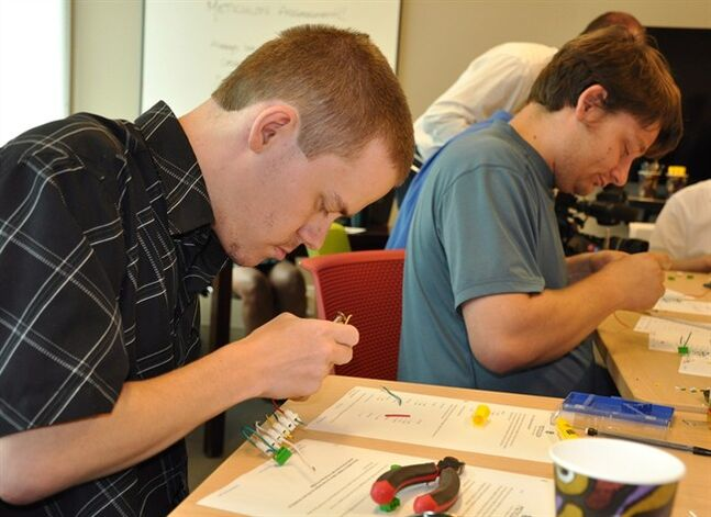 Logan Olafson (left) and Matthew Ford work on electronics in a handout photo. THE CANADIAN PRESS/HO, Meticulon