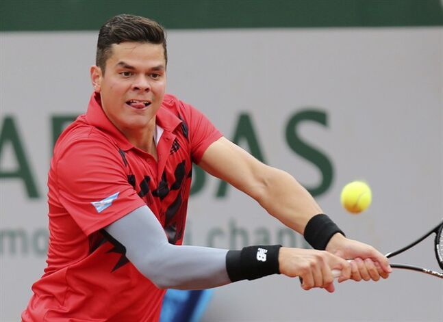 Canada's Milos Raonic returns to Australia's Nick Kyrgios in Paris Sunday.