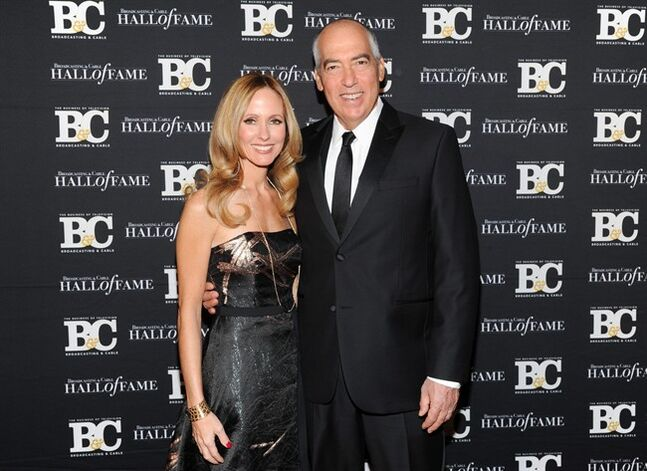 FILE - This Oct. 28, 2013 file photo shows Twentieth Century Fox Television chairmen and CEOs Dana Walden, left, and Gary Newman at the 23rd Annual Broadcasting & Cable Hall of Fame Awards in New York. Fox says that Gary Newman and Dana Walden, the two executives who run the company's television studio, will also be in charge of the Fox broadcast network. The appointment announced Monday, July 14, 2014, aligning 20th Century Fox Television with the network brings back a structure Fox had for five years ending a decade ago. (Photo by Evan Agostini/Invision/AP, File)