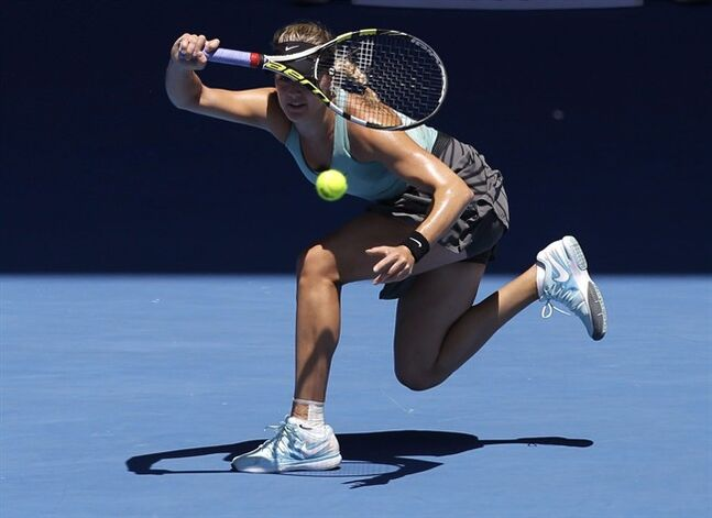Eugenie Bouchard plays a shot to Li Na of China during their semifinal at the Australian Open tennis championship in Melbourne, Australia, Thursday, Jan. 23, 2014. Bouchard will lead Canada's team at a Fed Cup women's tennis tie against Serbia next month. THE CANADIAN PRESS/AP/Aijaz Rahi