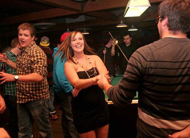 Allscott Trach takes Ashley Bengtson for a swing at Houstons Country Roadhouse on New Year's Eve.