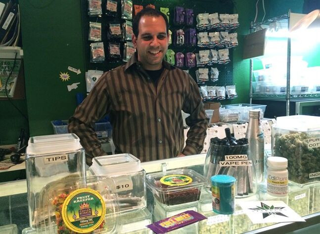 Brian Ruden, owner of Starbuds, one of the first recreational marijuana stores in the United States, displays some of his products including vaporized e-joints and edibles in Denver, Co., Aug. 21, 2014. THE CANADIAN PRESS/ Alexander Panetta