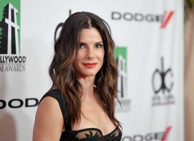 FILE - In this Oct. 21, 2013 file photo, Sandra Bullock arrives at the 17th Annual Hollywood Film Awards Gala at the Beverly Hilton Hotel in Beverly Hills, Calif. Police arrested an intruder on Sunday morning, June 8, 2014, at the Los Angeles home of Bullock while the actress was there, but she wasn't hurt. Los Angeles police spokeswoman Nuria Vanegas says police responded to the call of a prowler at about 6:30 a.m. and arrested 39-year-old Joshua Corbett on suspicion of residential burglary. (Photo by John Shearer/Invision/AP, file)