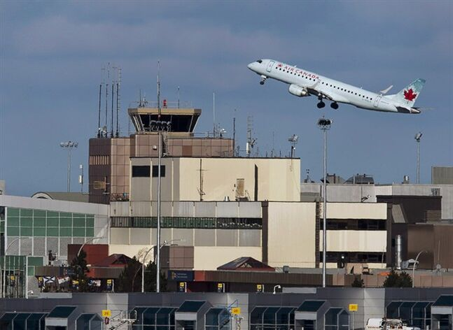 An Air Canada passenger jet takes off over the terminal at Halifax Stanfield International Airport in Halifax on Jan. 21, 2013. The Canadian government is laying out stricter rules to ensure clean water aboard planes, trains and passenger ships for drinking, hand washing, oral hygiene and food preparation. THE CANADIAN PRESS/Andrew Vaughan