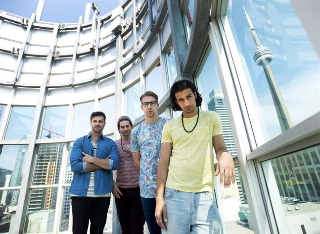 Magic! band members Mark Pelli, left, Ben Spivak, second left, Alex Tanas, second right, and Nasri Atweh pose in Toronto on Monday, June 16, 2014. THE CANADIAN PRESS/Nathan Denette