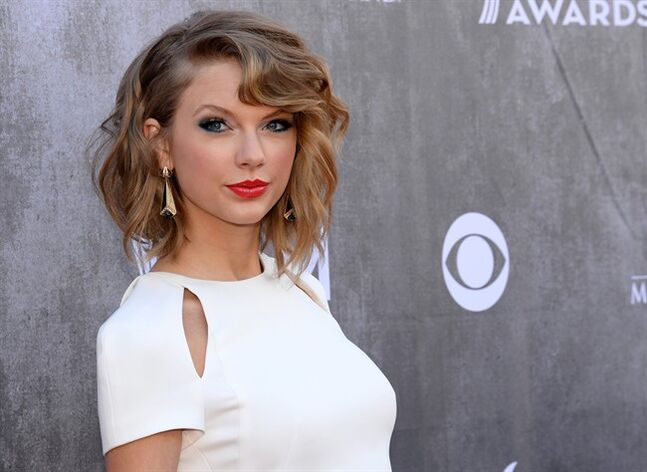 FILE - In this April 6, 2014 file photo, singer Taylor Swift arrives at the 49th annual Academy of Country Music Awards at the MGM Grand Garden Arena in Las Vegas. Daniel Cole, 39, of Brewster, Mass., was sentenced to probation Thursday, July 18, 2014, after being found guilty of trespassing at Swift's seaside mansion in Rhode Island. (Photo by Al Powers/Powers Imagery/Invision/AP, File)