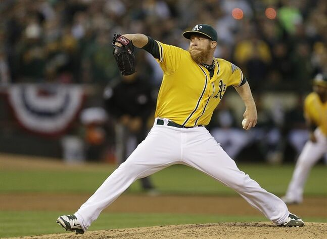 Oakland Athletics' Sean Doolittle works against the Toronto Blue Jays in the ninth inning of a baseball game on Thursday, July 3, 2014, in Oakland, Calif. (AP Photo/Ben Margot)