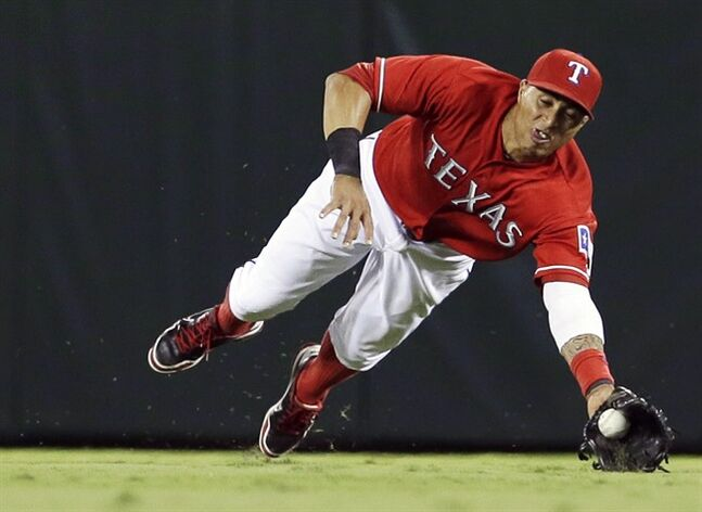 Texas Rangers' Leonys Martin dives for a ball Sept. 30, 2013, in Arlington, Texas. THE CANADIAN PRESS/AP, Tony Gutierrez