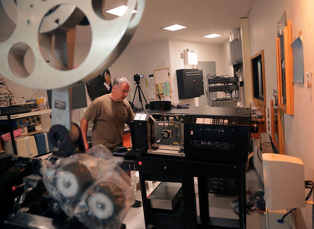 Jacques Blackstone installs a new digital movie projector in the Evans Theatre on the Brandon University campus last week. The local theatre purchased the $65,000 projector with help from its Save Our Screen fundraising campaign.