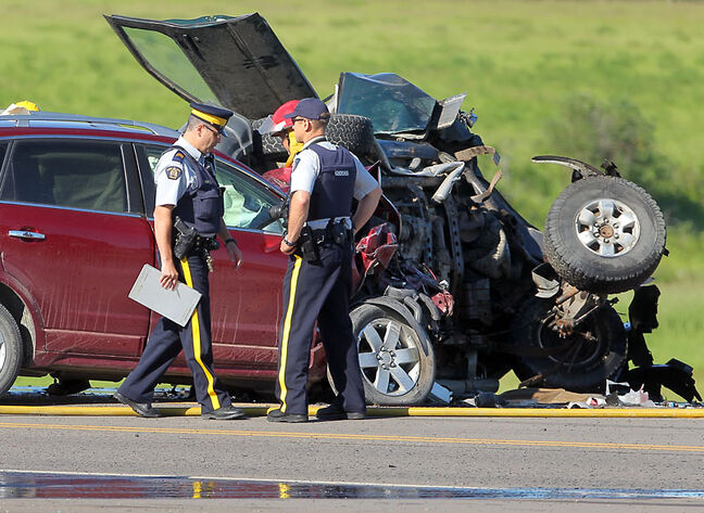 Emergency crews work at the scene of a five-vehicle crash near the corner of Highway 10 and Highway 25, near the turnoff to Rivers, Friday morning.