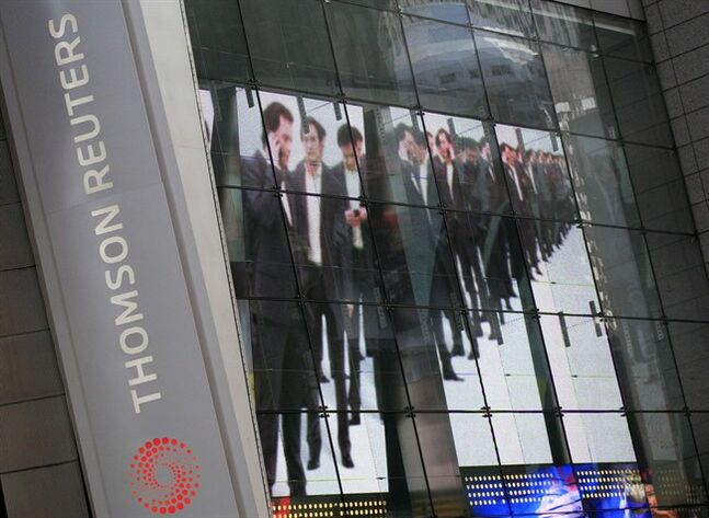 An electronic display advertising is shown on the Thomson Reuters building in New York on Aug. 4, 2009. THE CANADIAN PRESS/AP, Mark Lennihan