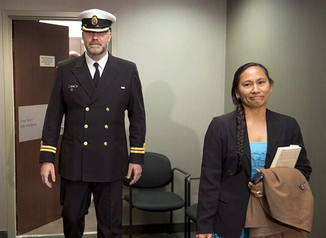 Lt. Derek De Jong and his wife Maria head from court after his court martial in Halifax on Wednesday, May 7, 2014. De Jong was given a severe reprimand and a $5,000 fine for deserting his post on a navy supply vessel in September 2012. THE CANADIAN PRESS/Andrew Vaughan
