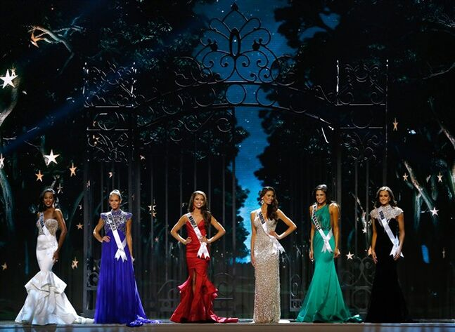 Miss Georgia USA Tiana Griggs, from left, Miss Louisiana USA Brittany Alyson Guidry, Miss Nevada USA Nia Sanchez, Miss Florida USA Brittany Oldehoff, Miss North Dakota USA Audra Mari and Miss Iowa USA Carlyn Bradarich, stand during the Miss USA pageant in Baton Rouge, La., Sunday, June 8, 2014. Sanchez would go on to win the Miss USA title. (AP Photo/Jonathan Bachman)