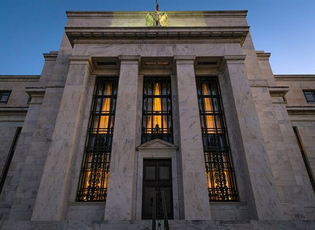 FILE - This Sept. 18, 2013 file photo shows the Federal Reserve headquarters in Washington. Minutes of the Fed's discussion at its July 29-30, 2014 meeting show that some officials thought the economy was improving enough that the Fed would need