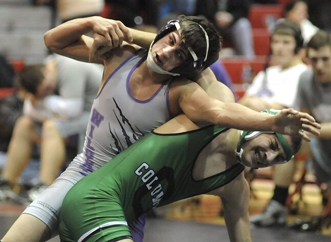 FILE - This Jan. 16, 2014 file photo shows Keystone High School wrestler Logan Stiner, top, during a match in Sheffield Village, Ohio. A recent autopsy found that the 18-year-old Stiner had a lethal amount of caffeine in his system when he died May 27, 2014. The sudden death of a healthy high school senior has ramped up attention on unregulated caffeine powder and the ease of taking a toxic dose. (AP Photo/The Chronicle Telegram, Steve Manheim)