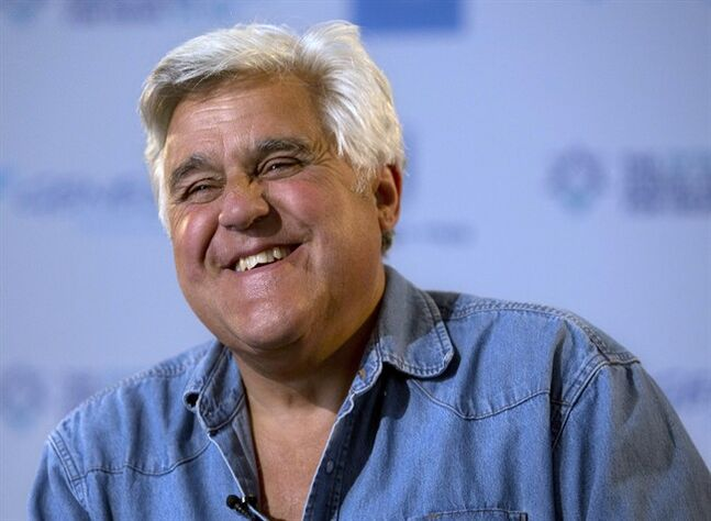 "FILE - This May 21, 2014 file photo shows American comedian Jay Leno reacts during an interview with the Associated Press in Jerusalem. Newly retired from ""The Tonight Show,"" Leno is now being awarded the nation's top humor prize by the Kennedy Center for the Performing Arts. Leno will be honored with the Mark Twain Prize for American Humor by his fellow comedians in a performance Oct. 19 in Washington. The show will be broadcast nationally in November on PBS. (AP Photo/Sebastian Scheiner, File)"