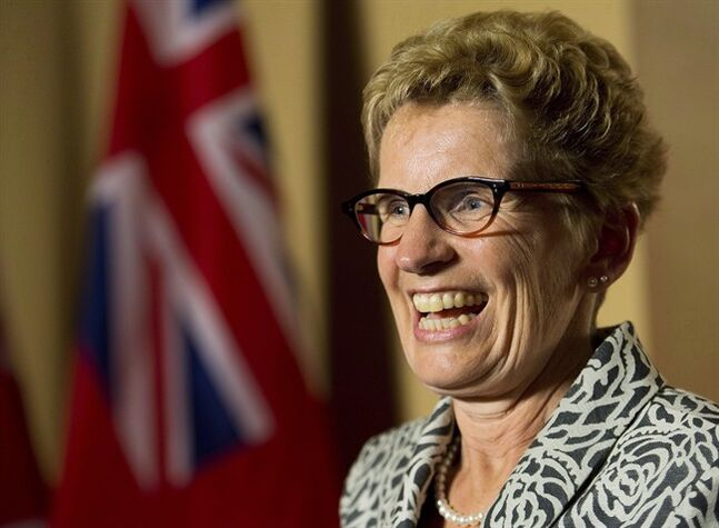Ontario Premier Kathleen Wynne smiles as she speaks to the media after winning a majority government at Queen's Park in Toronto on Friday, June 13, 2014. THE CANADIAN PRESS/Nathan Denette
