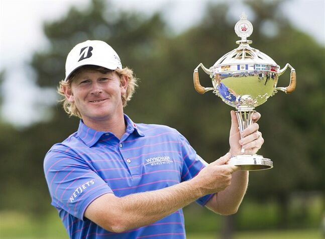 Brandt Snedeker of the United States poses with the championship trophy after winning the Canadian Open in Oakville, Ont., on Sunday, July 28, 2013. It's been a rough season for Snedeker but the 2012 Fed Ex Cup champion hopes to have his game ready to defend his RBC Canadian Open title in July. THE CANADIAN PRESS/Nathan Denette