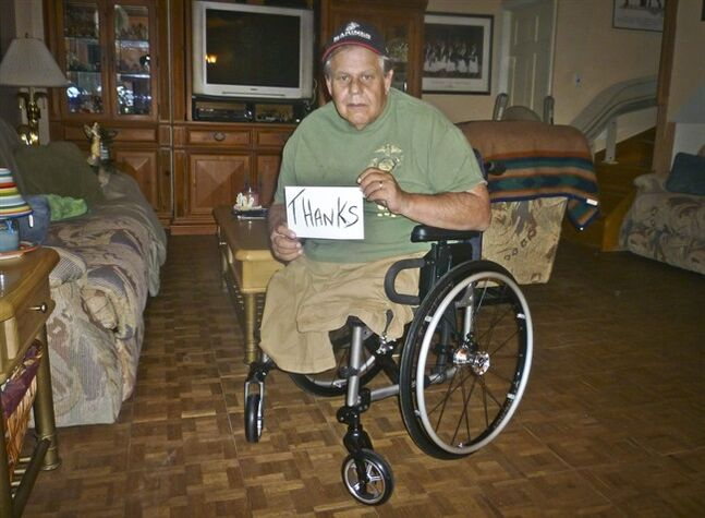 In this July 15, 2014 photo, Michael Sulsona, a Vietnam War veteran who lost both legs to a land mine 40 years ago, poses with a