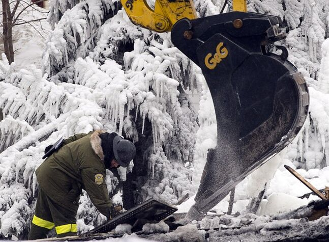 Emergency workers continue the search for victims Saturday, January 25, 2014 in L'Isle-Verte, Que. at the scene of a fatal fire at a seniors residnce Thursday, Jan, 22, 2014. THE CANADIAN PRESS/Ryan Remiorz